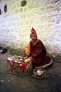 Mendicant monk at base of Potala, Lhasa
