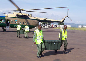 Rwandan Defence Forces - Rwandan soldiers carrying equipment at Kigali International Airport