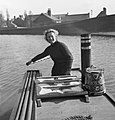 Miss March manning the tiller of the narrowboat 'HEATHER BELL' nas it carried flour from Worcester to Tipton during 1942. D7652.jpg