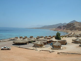 2004 Sinai bombings - Moon Island beach resort in June 2004, four months before the deadly terrorist attack. Most of the restaurant compound (the larger structures in front) was destroyed in the blast.