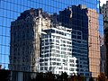 NYC - 90 West Street and World Center Hotel is reflected in Four World Trade Center - panoramio.jpg