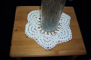 Doily - A crocheted doily in use