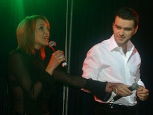 Nico (Romanian singer) - Nico (left) with Vlad Miriţă performing Pe-o margine de lume in the UK, during the Promo Tour