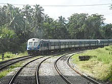 A passenger train rounds a curve