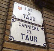 This bilingual street sign in Tolosa (Toulouse), like many such signs found in historical parts of the city, is maintained primarily for its antique charm; it is typical of what little remains of the lenga d'oc in southern French cities.