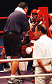 Olanda Anderson drinks some water as he sits in the red corner during his bout with Rudolf Kraj, 2000-jpg.jpg