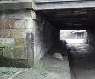 Monkland Canal - Grooves worn by ropes of canal barges at Townhead on the Cut of Junction, now pedestrian subway under Castle Street at Royston Road