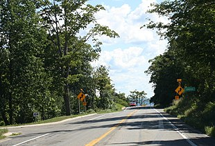 """Looking south at Omena on <a href=""""http://search.lycos.com/web/?_z=0&q=%22M-22%20%28Michigan%20highway%29%22"""">M-22</a>"""