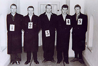Police lineup - Fredrik Fasting Torgersen in the center of a police lineup.