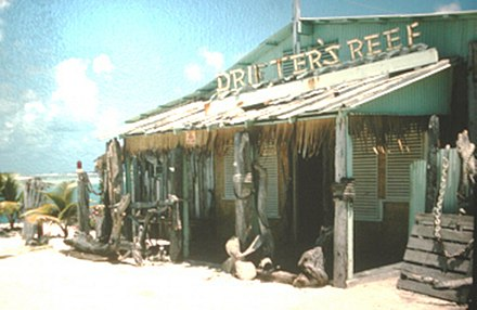 "The original Drifter's Reef bar, built near the harbor area at Wake Island, opened its doors to aircrews, visitors and other ""drifters"" on November 8, 1949. Original Drifter's Reef bar, Wake Island.jpg"