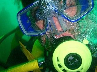 Diving mask - Scuba diver with bifocal lenses in half mask
