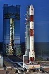 PSLV C42 vehicle on the First Launch Pad with mobile service tower in the background.jpg