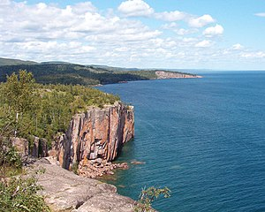 Duluth Complex - North Shore Volcanics:  Palisade Head (foreground) and Shovel Point (midground), both rhyolitic extrusions of the Midcontinent Rift; Sawtooth Mountains on horizon