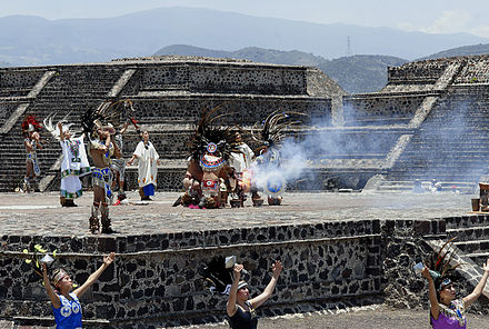 A ceremony is held at the Teotihuacan pyramids to light the torch. Pan Flame Rio 2007.jpg