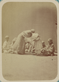 Pastimes of Central Asians. Two Boys Wrestling in Front of a Group WDL10812.png