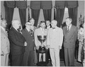 "Photograph of President Truman in the Oval Office, receiving the driver and owners of ""Miss Pepsi,"" the winning boat... - NARA - 200232.tif"