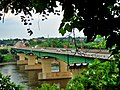 Pie-IX bridge view between the foliages at Laval - panoramio.jpg