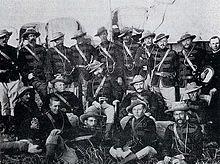 A group photograph of uniformed military officers of colonial appearance.