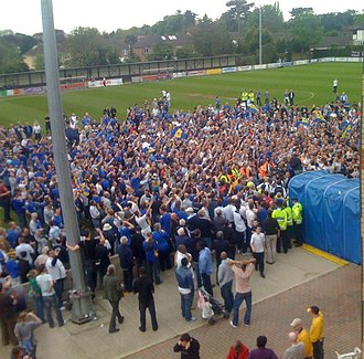AFC Wimbledon - AFC Wimbledon fans and players celebrating promotion to the Conference South having beaten Staines Town 2–1 in the 2008 Isthmian League Premier Division Play-off Final.