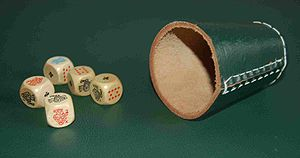 Poker dice - A set of poker dice and a dice cup