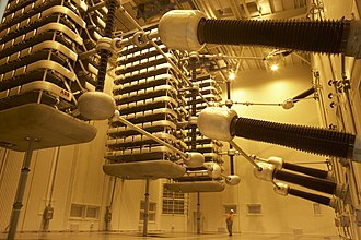 High-voltage direct current - Thyristor valve stacks for Pole 2 of the HVDC Inter-Island between the North and South Islands of New Zealand. The man at the bottom gives scale to the size of the valves.