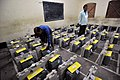 Polling officials checking the Electronic Voting Machines (EVM`s) required for the Tripura Assembly Election, in Agartala, Tripura on February 13, 2013.jpg