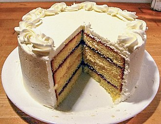Cake - layered pound cake filled with raspberry jam and lemon curd, and finished with buttercream frosting