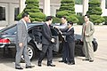 President Lee, being escourted by a young security guard (4437070299).jpg