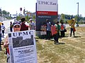 Protesters at UPMC East Entrance (7488894582).jpg