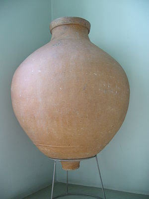 Pithos - Marine pithos. Note the lug on the bottom for insertion into a rack built across the hold. The faint relief lines on the bottom are probably strengtheners. The mouth is small-diameter for easier sealing. A lip strengthens the rim.