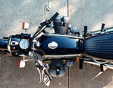 Top-down view of a black R75/5 showing that the cylinders which protrude out of each side of the bike are not directly opposite each other
