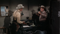 Randolph Scott and Barry Kelley in Buchanan Rides Alone.png