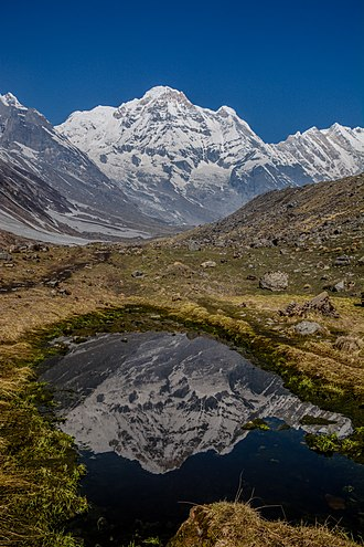 Annapurna Massif - Reflection of Annapurna Dakshin (South) Mountain in fresh water