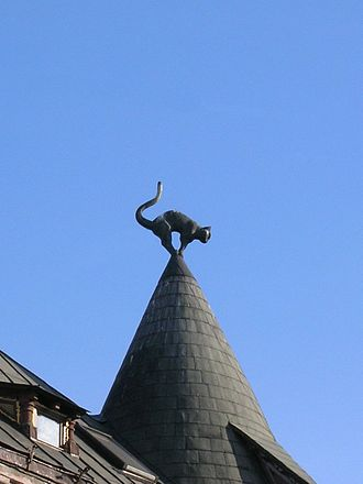 Cat House, Riga - Angry-looking cat on turret rooftop