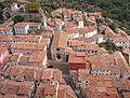 Roccalbegna, chiesa dei santi pietro e paolo, veduta dalla rocca.jpg