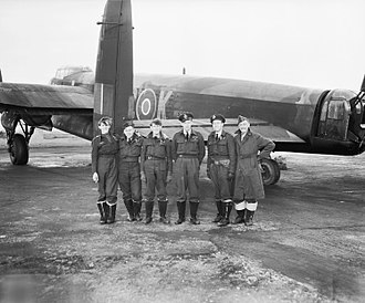 RAF Lossiemouth - A No. 617 Squadron crew and their Lancaster following the successful operation launched from Lossiemouth against the battleship Tirpitz on 12 November 1944.