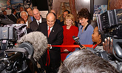 Giuliani cutting the ribbon of the new Drug Enforcement Agency mobile museum in Dallas, Texas in September 2003