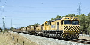 Rail transport in Western Australia - Modern S class diesel locomotive on a bauxite train at Wellard.