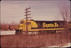 SANTA FE RAILROAD ENGINE ON THE TRACKS IN JOHNSON COUNTY KANSAS, NEAR KANSAS CITY. TALLGRASS PRAIRIE IS SEEN IN THE... - NARA - 557187.jpg