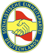 The SED emblem represented the handshake between Communist Wilhelm Pieck and Social Democrat Otto Grotewohl when their parties merged in 1946