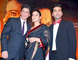 Shah Rukh Khan - Khan with director Karan Johar and co-star Kajol at an event for My Name Is Khan in 2010