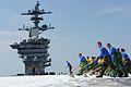 Sailors scrub flight deck aboard USS Theodore Roosevelt. (9612686469).jpg