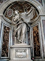 This statue shows the saint as a young woman, who, with a dramatic gesture, displays a cloth on which there is an image of the face of Jesus.