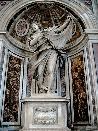 Saint Veronica - Statue of Saint Veronica by Francesco Mochi in a niche of the pier supporting the main dome of Saint Peter's Basilica.