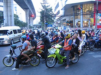 Motorcycle taxi - Drivers of motorcycle taxis in Bangkok wear orange vests.