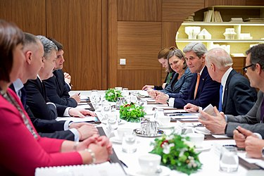 Secretary Kerry Listens as Vice President Biden Addresses Ukrainian President Poroshenko During a Bilateral Meeting in Davos (23880371663).jpg
