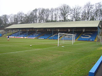 Hyde Road (stadium) - The Shay, Halifax, in 2006. The left hand portion of the pictured stand's roof was originally used at Hyde Road.
