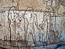 "Shoshenq III, standing on the boat ""msktt"", the boat of the night, with the god Atum. From his tomb in Tanis."