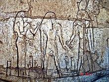 """Shoshenq III, tanrı Atum ile gecenin kayığı """"msktt"""" teknesinde duruyor.  Tanis'teki mezarından."""
