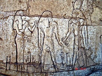 "Shoshenq III - Shoshenq III, standing on the boat ""msktt"", the boat of the night, with the god Atum. From his tomb in Tanis."